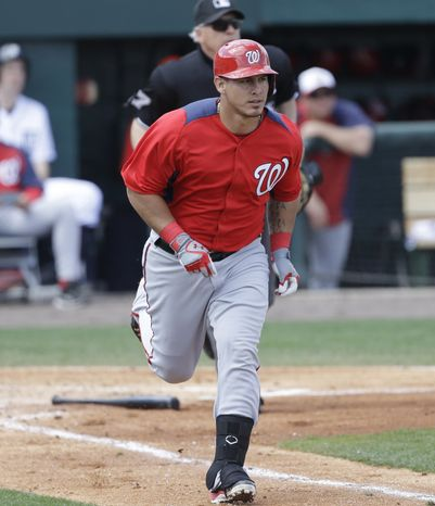 Washington Nationals' Wilson Ramos runs to first as he pops up during the fourth inning of an exhibition spring training baseball game against the Detroit Tigers, Sunday, March 10, 2013 in Lakeland, Fla. (AP Photo/Carlos Osorio)