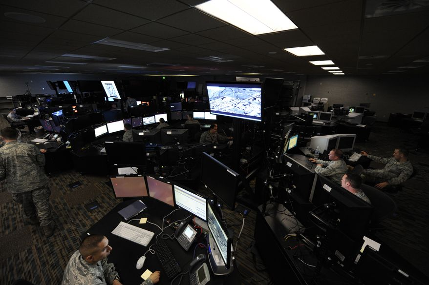 Air Force analysts in the operations center of the 497th Intelligence, Surveillance and Reconnaissance Group at Langley Air Force Base in Hampton, Va., monitor combat operations in Afghanistan. (AP Photo/U.S. Air Force)