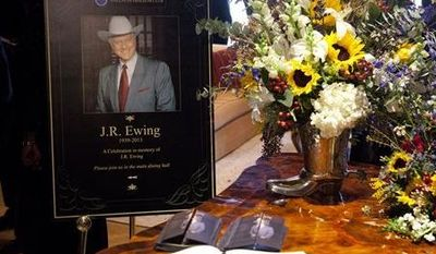 """Funeral scene for the character J.R. Ewing, played by Larry Hagman, in an episode of """"Dallas,"""" airing Monday at 9 p.m. Hagman died of cancer at 81 the day after Thanksgiving. (AP Photo/TNT, Skip Bolen)"""