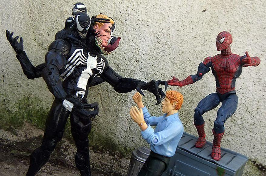 Norman Osborn tries to calm down Diamond Select Toys' Venom while Spider-Man looks on. (Photograph by Joseph Szadkowski / The Washington Times)