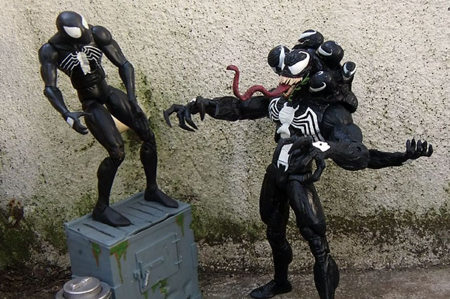 A dazed Spider-Man (in classic black symbiote costume) awaits the judgement of Diamond Select Toys' Venom. (Photograph by Joseph Szadkowski / The Washington Times)