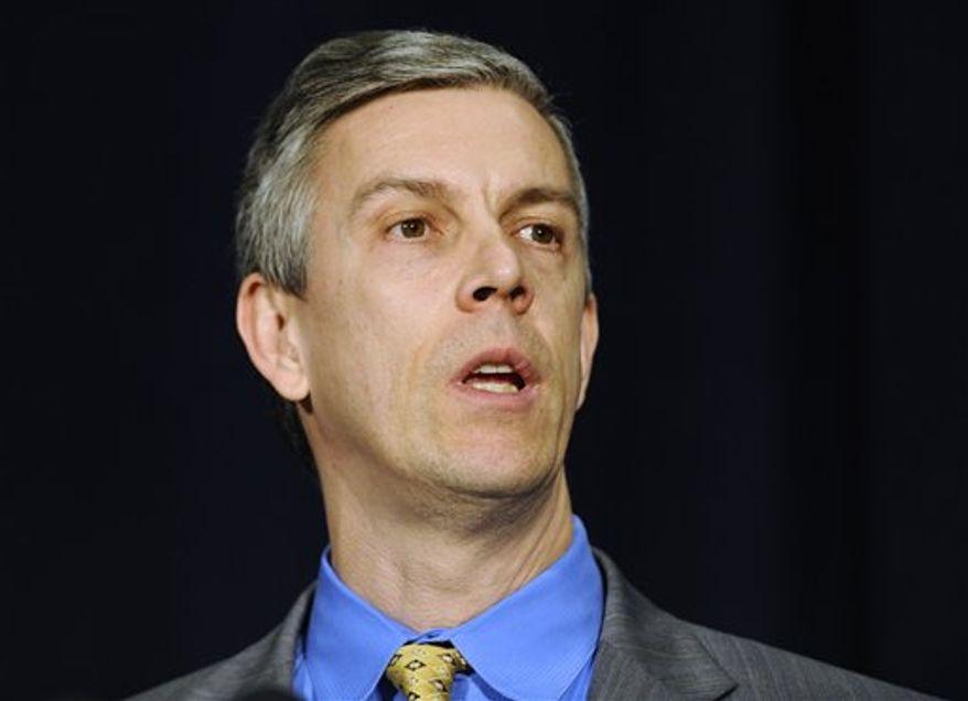 ** File ** U.S. Secretary of Education Arne Duncan speaks at a gun violence conference in Danbury, Conn., Thursday, Feb. 21, 2013. (AP Photo/Jessica Hill)