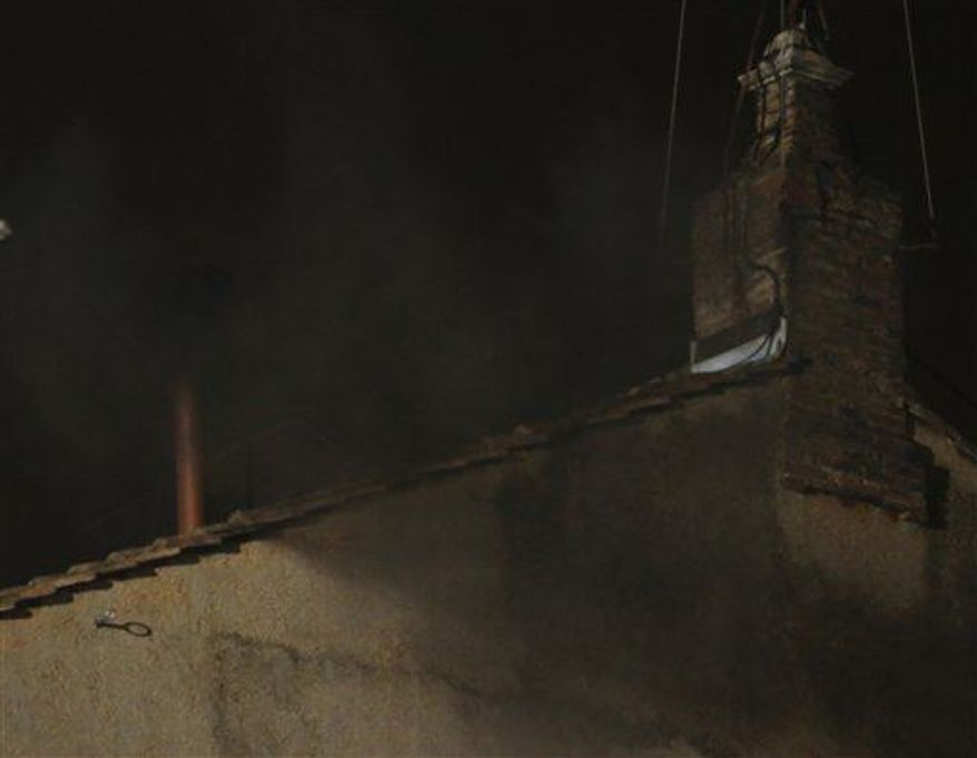 Black smoke emerges from the chimney on the roof of the Sistine Chapel, in St. Peter's Square at the Vatican, Tuesday, March 12, 2013. The black smoke indicates that the new pope has not been elected yet. (AP Photo/Dmitry Lovetsky)