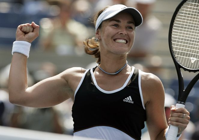 **FILE** In this Aug. 30, 2007 file photo, Swiss tennnis player Martina Hingis celebrates after defeating Pauline Parmentier of France at the US Open tennis tournament in New York. Five-time Grand Slam singles champion Hingis heads the 2013 class for the International Tennis Hall of Fame. The other new members of the Hall announced Monday, March 4, 2013 are Cliff Drysdale, Charlie Pasarell, and Ion Tiriac. Australian player Thelma Coyne Long's election was announced earlier. (AP Photo/Julie Jacobson, File)