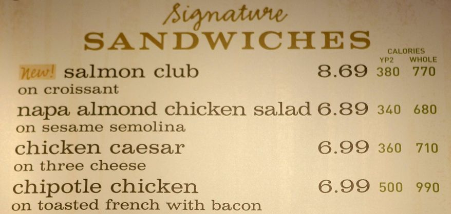 ** FILE ** In this March 8, 2010, file photo, the sandwich board at the Panera store in Brookline, Mass., shows the calorie count for each item. Diners will have to wait a little longer to find calorie counts on most restaurant chain menus, in supermarkets and on vending machines. (AP Photo/Charles Krupa, File)