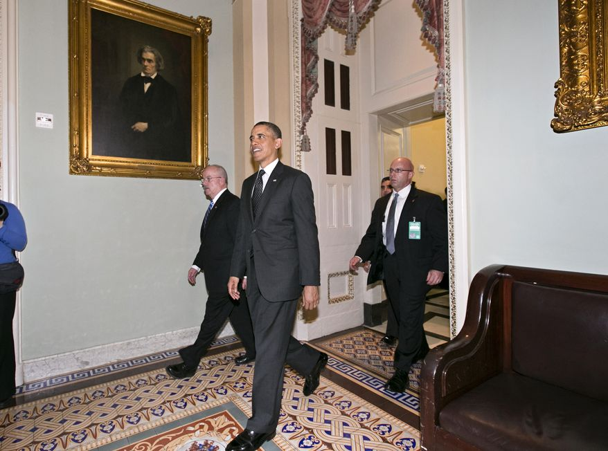 President Obama leaves the Capitol in Washington on March 12, 2013, after visiting with Senate Democrats in the first of four meetings with lawmakers this week to discuss the budget. (Associated Press)