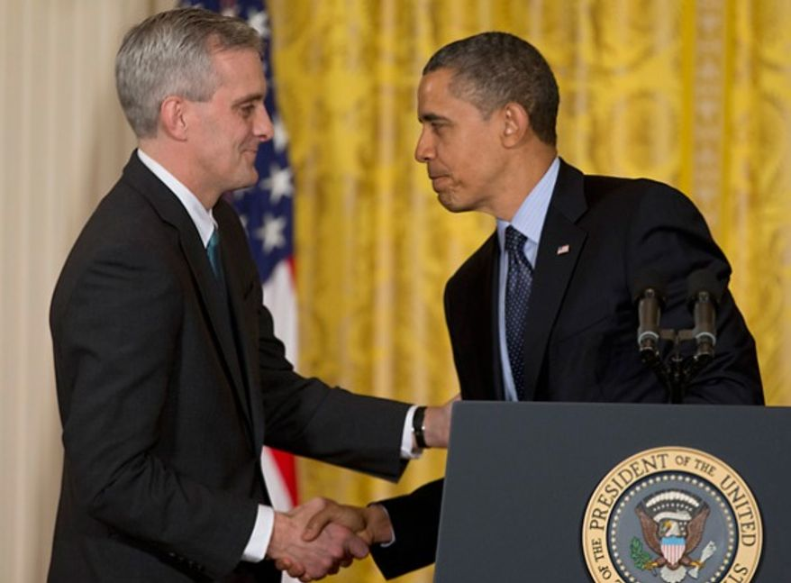 ** FILE ** President Obama shakes hands with then-Deputy National Security Adviser Denis McDonough in the East Room of the White House in Washington, where on Jan. 25, 2013, he announced he will name Mr. McDonough as his next chief of staff. (Associated Press)