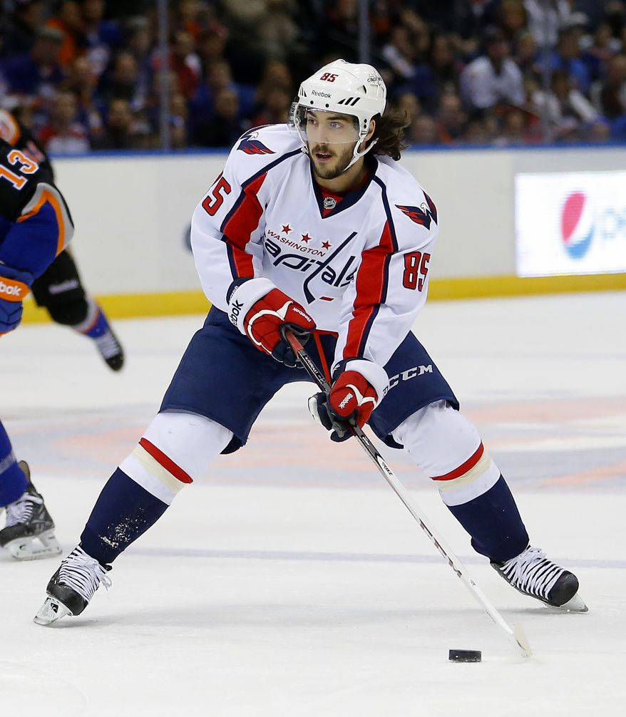 Washington Capitals center Mathieu Perreault (85) skates in an NHL hockey game against the New York Islanders at the Nassau Coliseum in Uniondale, N.Y., Saturday, March 9, 2013. (AP Photo/Paul J. Bereswill)