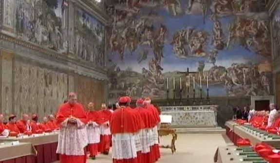 "In this image taken from video provided by CTV, cardinals line up to place their hands on the Gospel to ""promise pledge and swear"" to keep the oath of secrecy before taking their seats for the conclave to elect the next pope inside the Sistine Chapel in Vatican City Tuesday, March 12, 2013. (AP Photo/CTV)"