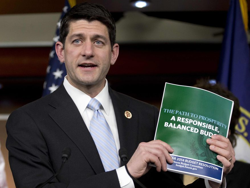 **FILE** House Budget Committee Chairman Rep. Paul Ryan, Wisconsin Republican, holds up a copy of the House Budget Committee 2014 Budget Resolution as he speaks during a news conference on Capitol Hill in Washington on March 12, 2013. (Associated Press)