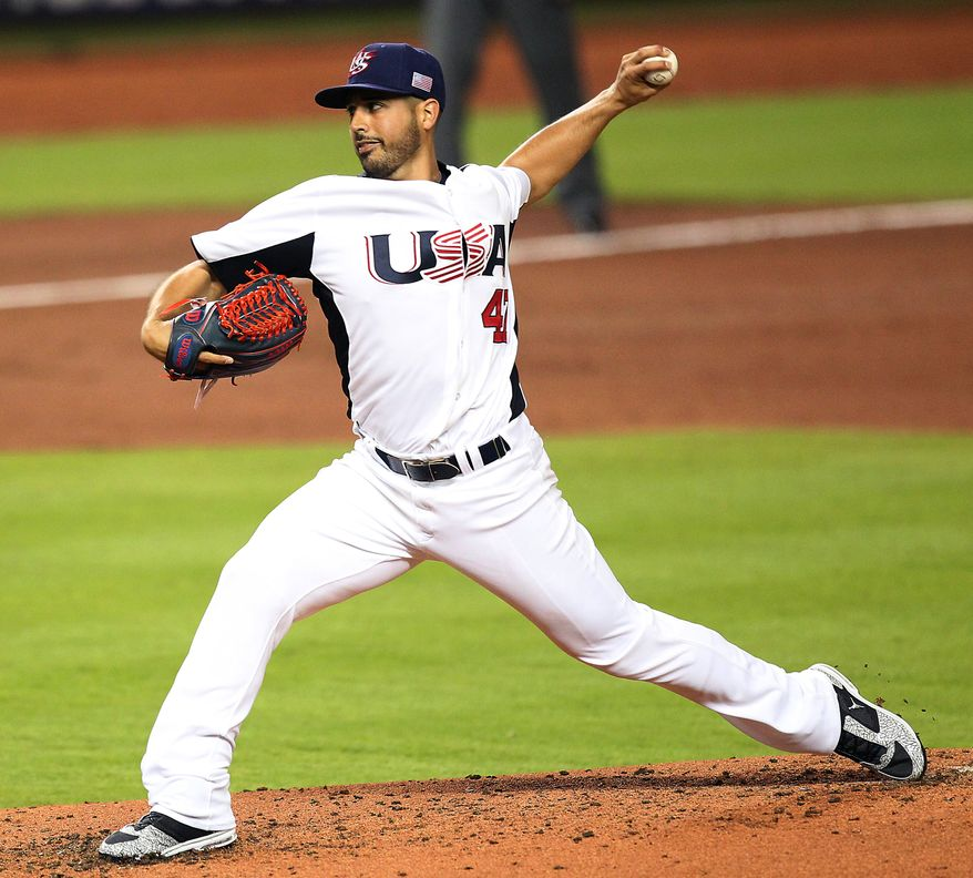 United States pitcher Gio Gonzalez delivers against Puerto Rico during the third inning of their second-round World Baseball Classic game, Tuesday, March 12, 2013, in Miami. (AP Photo/El Nuevo Herald, David Santiago)