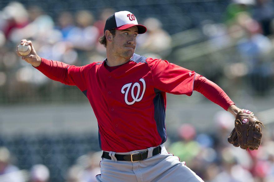 Washington Nationals pitcher Ross Ohlendorf delivers a pitch during the first inning of an exhibition spring training baseball game against the Houston Astros on Wednesday, March 13, 2013, in Kissimmee, Fla. (AP Photo/Evan Vucci)