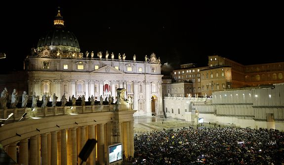 White smoke billows from the chimney on the Sistine Chapel indicating that a new pope has been elected in St. Peter's Square at the Vatican, Wednesday, March 13, 2013. (AP Photo/Andrew Medichini)