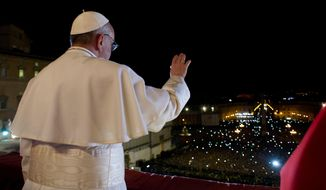 In this photo provided by the Vatican newspaper L'Osservatore Romano, Pope Francis waves the crowd from the central balcony of St. Peter's Basilica at the Vatican on March 13, 2013. Argentine Cardinal Jorge Mario Bergoglio, who chose the name of Pope Francis, is the 266th pontiff of the Roman Catholic Church. (Associated Press/L'Osservatore Romano)