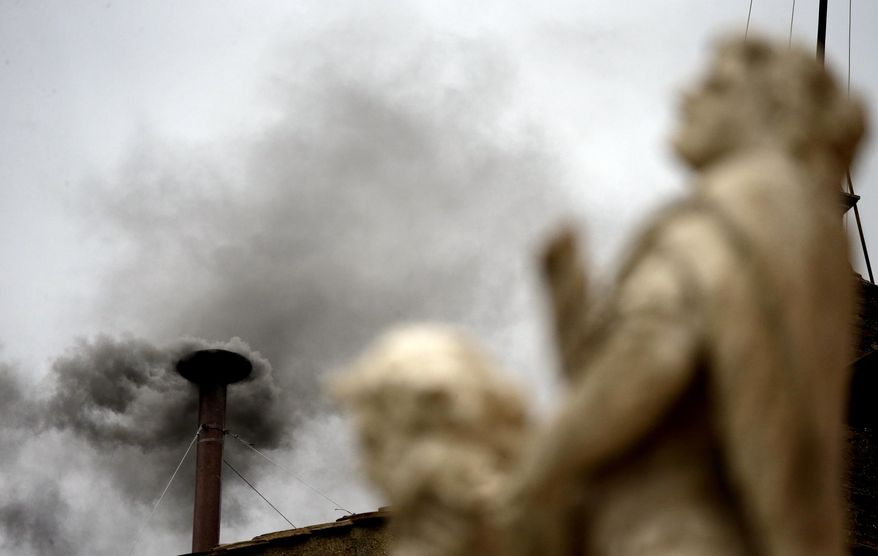 Black smoke billows from the chimney of the Sistine Chapel, meaning Roman Catholic cardinals have not elected a pope in their second or third rounds of balloting, at the Vatican, Wednesday, March 13, 2013. Cardinals voted twice Wednesday in Michelangelo's famed frescoed chapel after a first vote Tuesday in a conclave to elect a successor to Benedict XVI, who stunned the Catholic world last month by becoming the first pope in 600 years to resign. (AP Photo/Gregorio Borgia)