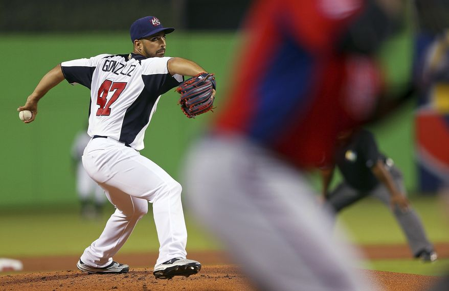 United States' Gio Gonzalez delivers a pitch during a World Baseball Classic second-round game against Puerto Rico, Tuesday, March 12, 2013, in Miami. The United States won 7-1. (AP Photo /Mike Ehrmann, Pool)