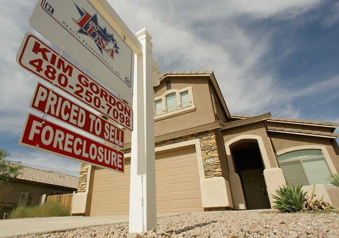 In February, the number of homes going into foreclosure saw a slight increase from January. But the rate was down from the same time last year, according to a monthly report from RealtyTrac. Bank repossessions also declined. (Associated Press)