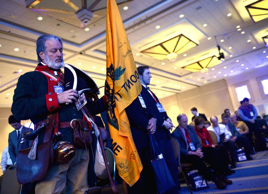 Tea party member William Temple of Brunswick, Ga., who dresses as Button Gwinnett, a representative of Georgia who was the second person to sign the Declaration of Independence, listens to the opening day invocation at CPAC. (Andrew Harnik/The Washington Times)