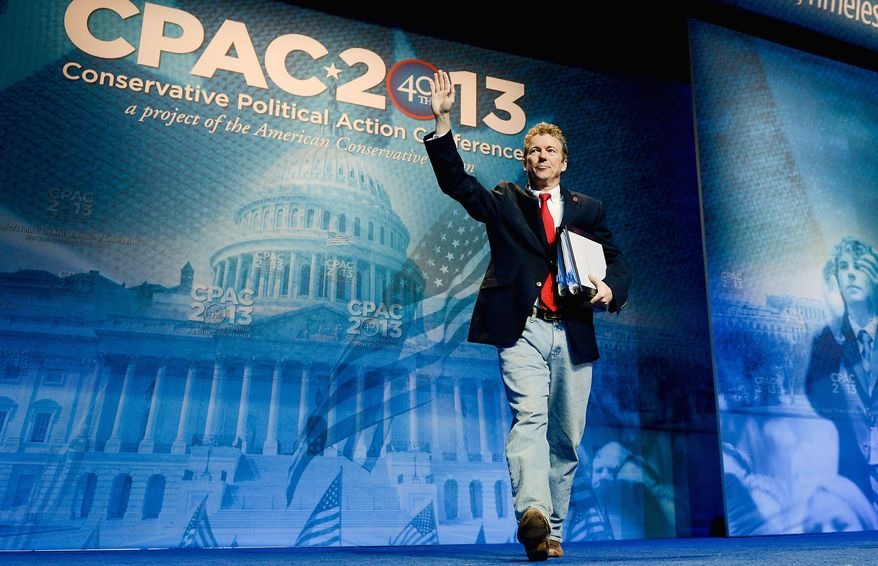 ** FILE ** Sen. Rand Paul, Kentucky Republican, acknowledges the response from the audience as he takes the stage to address the Conservative Political Action Conference at National Harbor in Maryland on Thursday, the first day of the gathering. (Photographs by Andrew Harnik/The Washington Times)