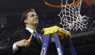 **FILE** Kentucky head coach John Calipari cuts down the net after the NCAA Final Four tournament college basketball championship game against Kansas Monday, April 2, 2012, in New Orleans. Kentucky won 67-59. (AP Photo/David J. Phillip)