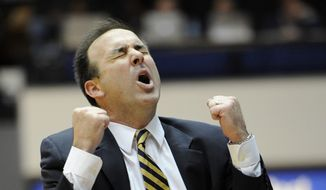 **FILE** George Washington coach Mike Lonergan reacts during the second half of an NCAA college basketball game against Butler, Saturday, Feb. 9, 2013, in Washington. Butler won 59-56. (AP Photo/Nick Wass)