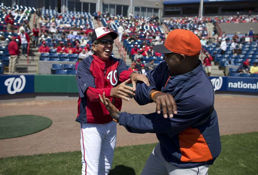 Washington Nationals manager Davey Johnson, left, jokes around with Houston Astros manager Bo Porter before the start of an exhibition spring training baseball game on Thursday, March 14, 2013, in Viera, Fla. (AP Photo/Evan Vucci)