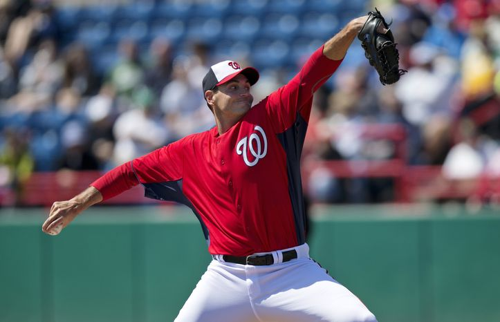 Washington Nationals pitcher Chris Young delivers a pitch during the first inning of an exhibition spring training baseball game against the Houston Astros on Thursday, March 14, 2013, in Viera, Fla. (AP Photo/Evan Vucci)