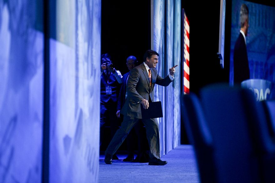 Texas Governor Rick Perry (R) takes the stage to speak at this year's Conservative Political Action Conference (C.P.A.C.) held at the Gaylord National Hotel, National Harbor, Md., Thursday, March 14, 2013. (Andrew Harnik/The Washington Times)