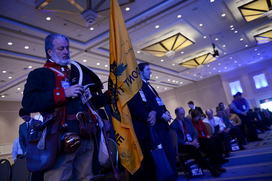 Tea Party member William Temple of Brunswick, Ga. who dresses as Button Gwinnett, a representative of Georgia who was the second to sign the Declaration of Independence, listens to the opening day invocation at this year's Conservative Political Action Conference (C.P.A.C.) held at the Gaylord National Hotel, National Harbor, Md., Thursday, March 14, 2013. (Andrew Harnik/The Washington Times)