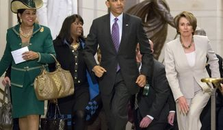 President Obama and House Minority Leader Nancy Pelosi, California Democrat, leave a meeting with House Democrats at the Capitol on March 14, 2013, joined by Democratic Reps. Frederica Wilson (left) of Florida and Terri Sewell (second from left) of Alabama. (Associated Press)