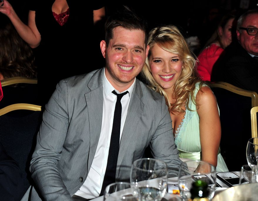 Canadian singer-songwriter Michael Buble and his wife, Argentine TV actress Luisana Lopilato, pose at the Nordoff Robbins 02 Silver Clef Awards at the London Hilton in London on June 29, 2012. (Jon Furniss/Invision/AP)