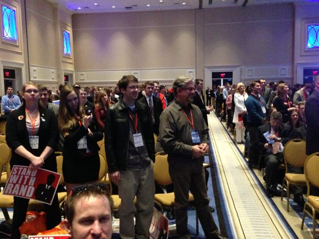 Many in the audience kept standing during Sen. Rand Paul's speech at the 40th annual Conservative Political Action Conference in National Harbor, Md., Thursday, March 14, 2013. (David S. Jackson/The Washington Times)