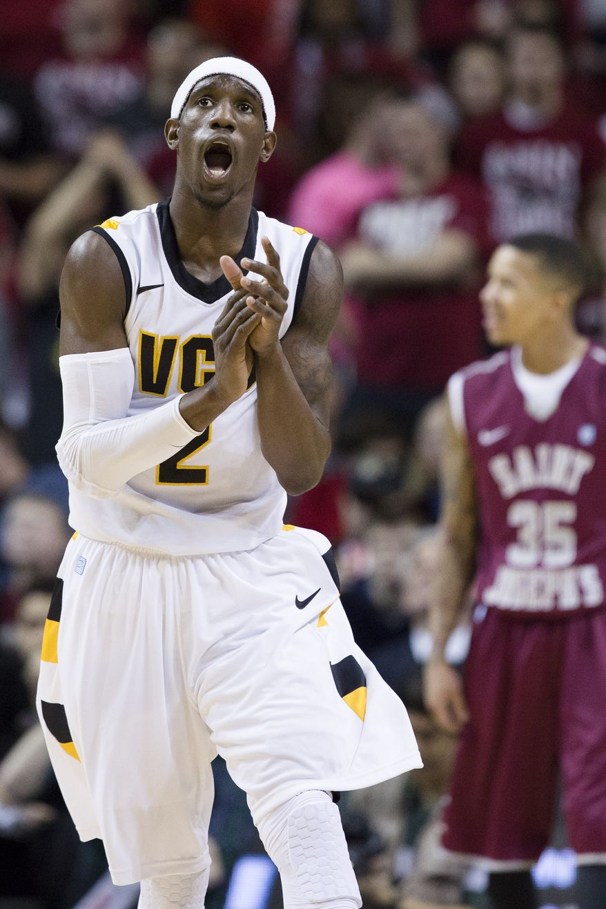 VCU's Briante Weber (2) reacts after scoring against Saint Joseph's during the first half of an NCAA college basketball game at the Atlantic 10 Conference tournament, Friday, March 15, 2013, in New York. (AP Photo/John Minchillo)