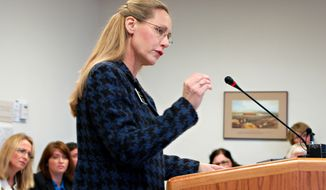 **FILE** Rep. Bette Grande testifies before the House Human Services Committee in Bismarck, N.D., on Jan. 31, 2013. (Associated Press)