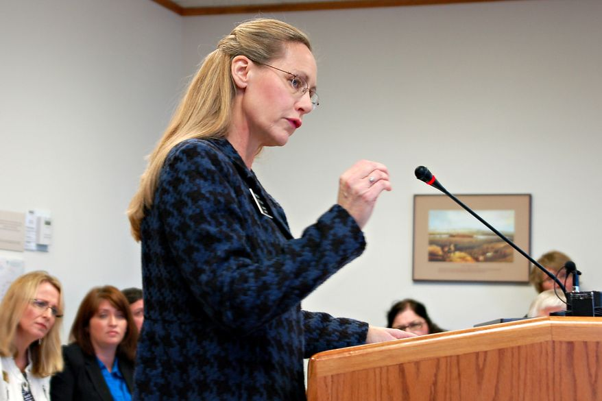 **FILE** Rep. Bette Grande testifies before the House Human Services Committee in Bismarck, N.D., on Jan. 31, 2013. (Associated Press)