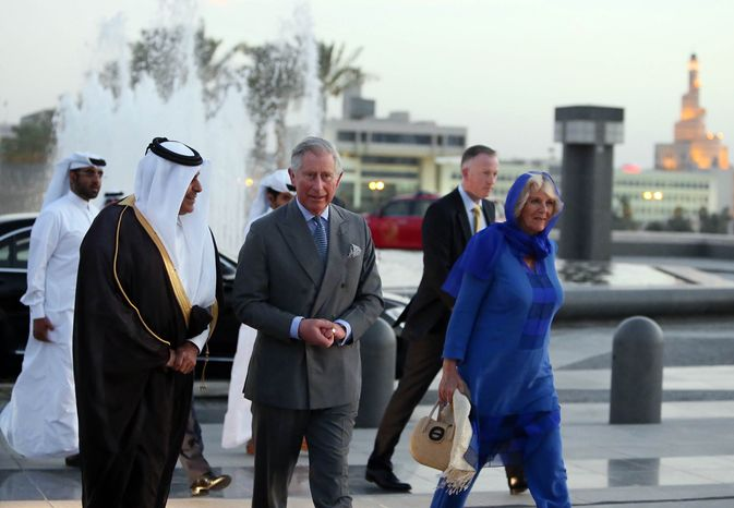 ** FILE ** Qatar's Sheikh Abdul Rahman Bin Saud Al Thani, left, escorts Prince Charles, center, and his wife Camilla during their visit to the Museum of Islamic Art in Doha, Qatar, Wednesday, March 13, 2013. (AP Photo/Osama Faisal)