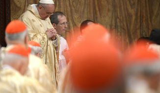 In this photo provided by the Vatican newspaper L'Osservatore Romano, Pope Francis celebrates his inaugural Mass with cardinals, inside the Sistine Chapel, at the Vatican, Thursday, March 14, 2013. (AP Photo/L'Osservatore Romano, ho)