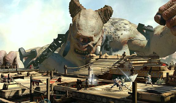 A cyclops keeps an eye on multiplayer battles in the Desert of Lost Souls in   the video game God of War: Ascension.