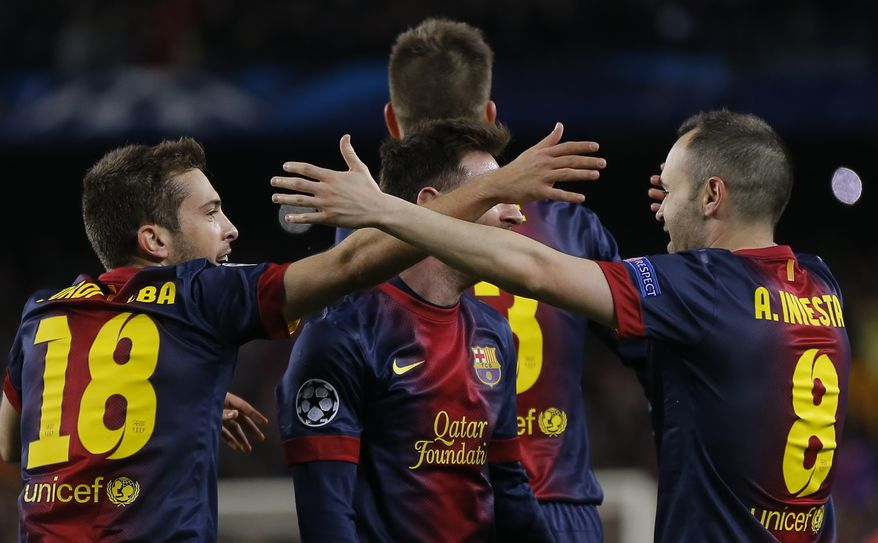 Barcelona players celebrate team's 4-0 victory during the Champions League round of 16 second leg soccer match between FC Barcelona and AC Milan at Camp Nou stadium, in Barcelona, Spain, Tuesday, March 12, 2013. (AP Photo/Daniel Ochoa de Olza)