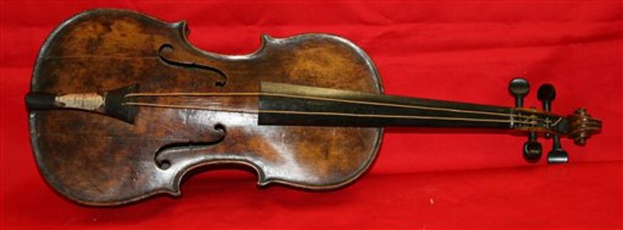This undated photo shows the violin that was played by bandmaster Wallace Hartley of the Titanic as the oceanliner sank. Hartley's violin was believed lost in the 1912 disaster, but auctioneers Henry Aldridge & Son say an instrument unearthed in 2006 has undergone rigorous testing and proven to be his. (AP Photo/Henry Aldridge)