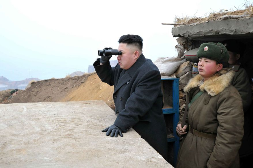 **FILE** In this March 7, 2013, photo released by the Korean Central News Agency, North Korean leader Kim Jong Un (center) uses binoculars to look at the South's territory from an observation post at the military unit on Jangjae islet, located in the southernmost part of the southwestern sector of North Korea's border with South Korea. (Associated Press/KCNA via KNS) **FILE**