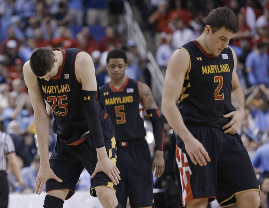 Maryland's Alex Len (25), Nick Faust (5), and Logan Aronhalt (2) head off the court after an NCAA college basketball game against North Carolina in the semifinals of the Atlantic Coast Conference men's tournament in Greensboro, N.C., Saturday, March 16, 2013. North Carolina won 79-76. (AP Photo/Gerry Broome)