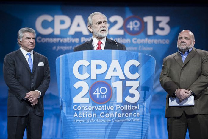 Larry Beasley, president and CEO of The Washington Times, speaks before the results of The Washington Times-CPAC 2013 Straw Poll are announced during the final day of the 2013 Conservative Political Action Conference in Fort Washington, Md., on March 16, 2013. Mr. Beasley is joined by Al Cardenas, left, chairman of the American Conservative Union, and pollster Tony Fabrizio, of the Fabrizio-McLaughlin polling firm that conducted the straw poll. Sen. Rand Paul (R-Ky.) was the winner, narrowly edging out the close second place Sen. Marco Rubio (R-Fla.). (T.J. Kirkpatrick/Special to The Washington Times)