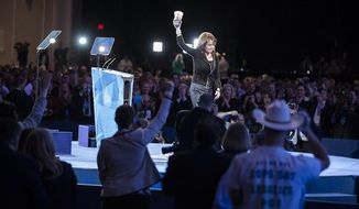 Former Alaska governor Sarah Palin leaves the stage carrying a 7-Eleven 'super big gulp' cup after speaking during the final day of the 2013 Conservative Political Action Conference in Fort Washington, Md. on March 16, 2013. The drink was a reference to an effort in New York City to ban sodas and sugary drinks from being sold in containers larger than 16 ounces, an effort that was struck down recently by a state Supreme Court judge.
