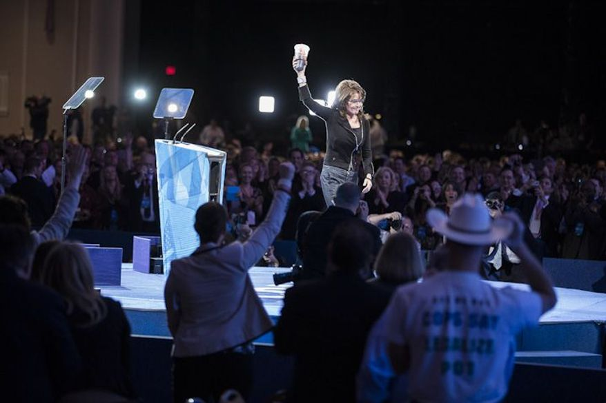 Former Alaska governor Sarah Palin leaves the stage carrying a 7-Eleven 'super big gulp' cup after speaking during the final day of the 2013 Conservative Political Action Conference in Fort Washington, Md. on March 16, 2013. The drink was a reference to an effort in New York City to ban sodas and sugary drinks from being sold in containers larger than 16 ounces, an effort that was struck down recently by a state Supreme Court judge. (T.J. Kirkpatrick/Special to The Washington Times)