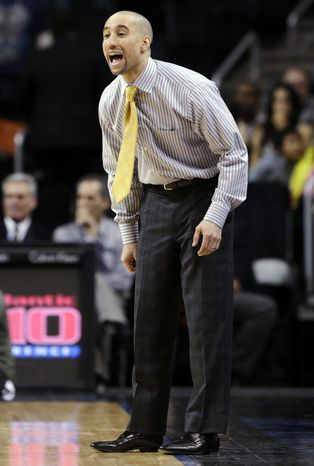 Virginia Commonwealth head coach Shaka Smart yells during the second half of an NCAA college basketball game against Saint Louis in the championship of the Atlantic 10 Conference tournament, Sunday, March 17, 2013, in New York. Saint Louis won 62-56. (AP Photo/Seth Wenig)