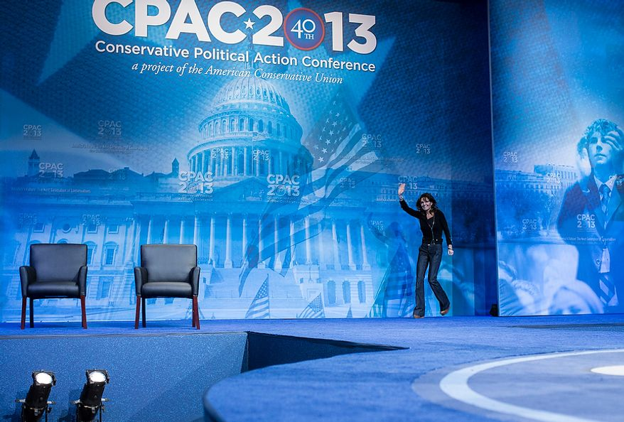 Former Alaska governor Sarah Palin takes the stage to speak during the final day of the 2013 Conservative Political Action Conference in Fort Washington, Md. on March 16, 2013.(T.J. Kirkpatrick/Special to The Washington Times)
