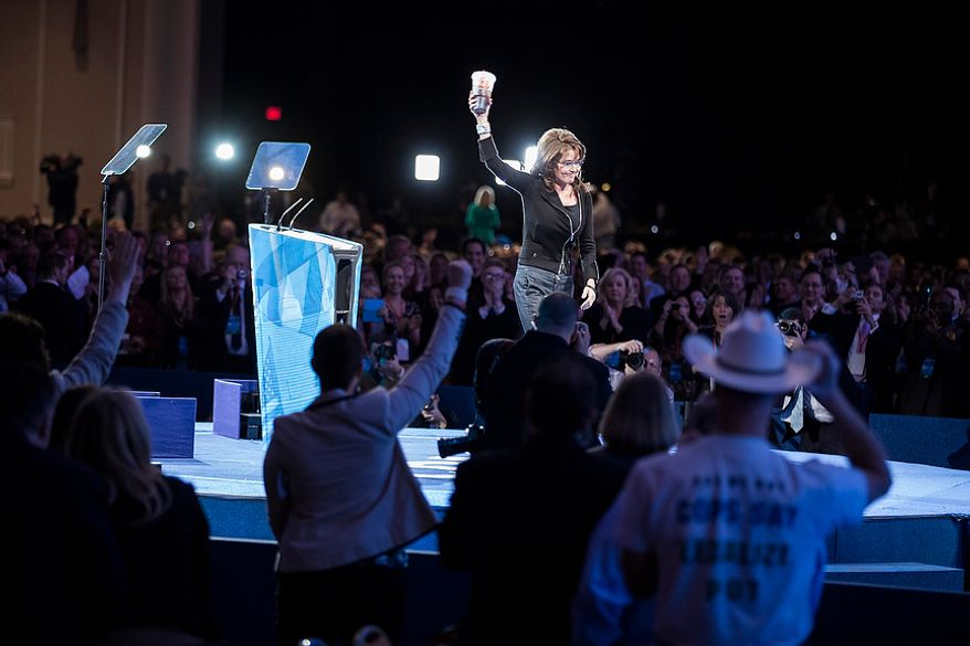 Former Alaska governor Sarah Palin leaves the stage carrying a 7-Eleven 'super big gulp' cup after speaking during the final day of the 2013 Conservative Political Action Conference in Fort Washington, Md. on March 16, 2013. The drink was a reference to an effort in New York City to ban sodas and sugery drinks from being sold in containers larger than 16 ounces, an effort that was struck down recently by a state Supreme Court judge.(T.J. Kirkpatrick/Special to The Washington Times)