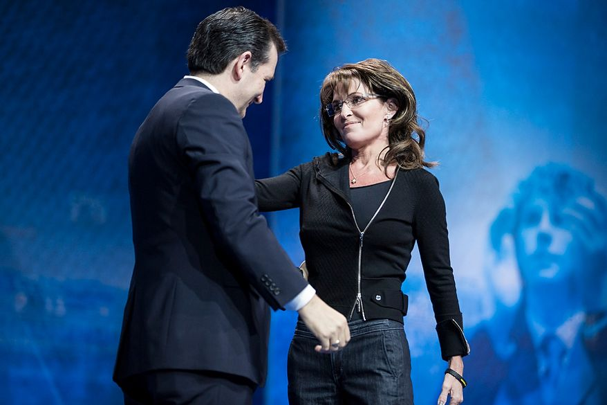 Former Alaska governor Sarah Palin greets Sen Ted Cruz (R-TX) as she takes the stage to speak during the final day of the 2013 Conservative Political Action Conference in Fort Washington, Md. on March 16, 2013.
