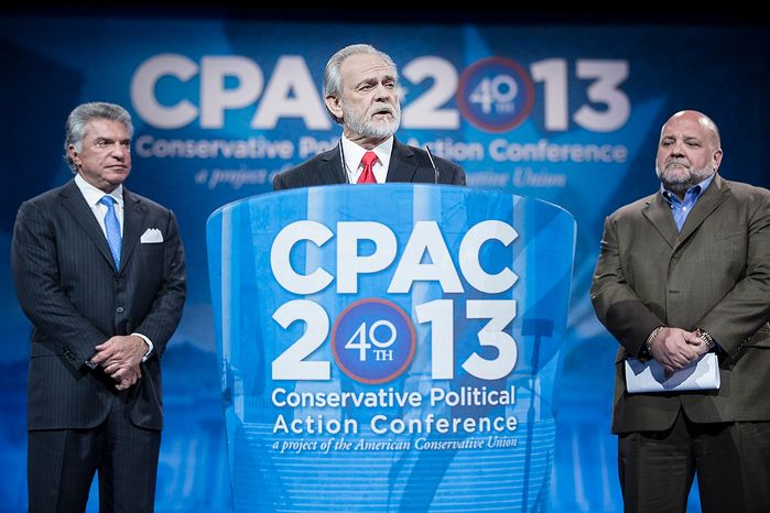 Larry Beasley, president and CEO of The Washington Times, speaks before the results of the Washington Times/CPAC 2013 straw poll are announced during the final day of the 2013 Conservative Political Action Conference in Fort Washington, Md. on March 16, 2013. Beasley is joined by Al Cardenas, left, chairman of the American Conservative Union, and pollster Tony Fabrizio, of the Fabrizio-McLaughlin polling firm that conducted the straw poll. Sen. Rand Paul (R-KY) was the winner, narrowly edging out the close second place Sen. Marco Rubio (R-FL). (T.J. Kirkpatrick/Special to The Washington Times)